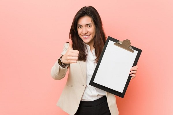 Woman pointing at the a students letter of recommendation for studying abroad