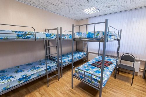A dorm room with bunk beds