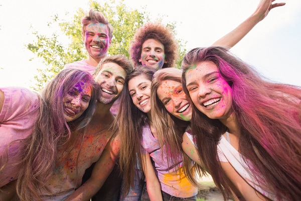 Students in university celebrating holi