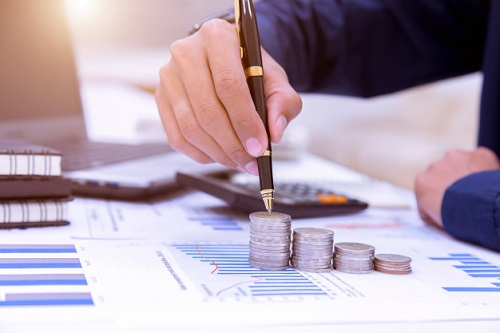Investment banker dealing with money and statistics